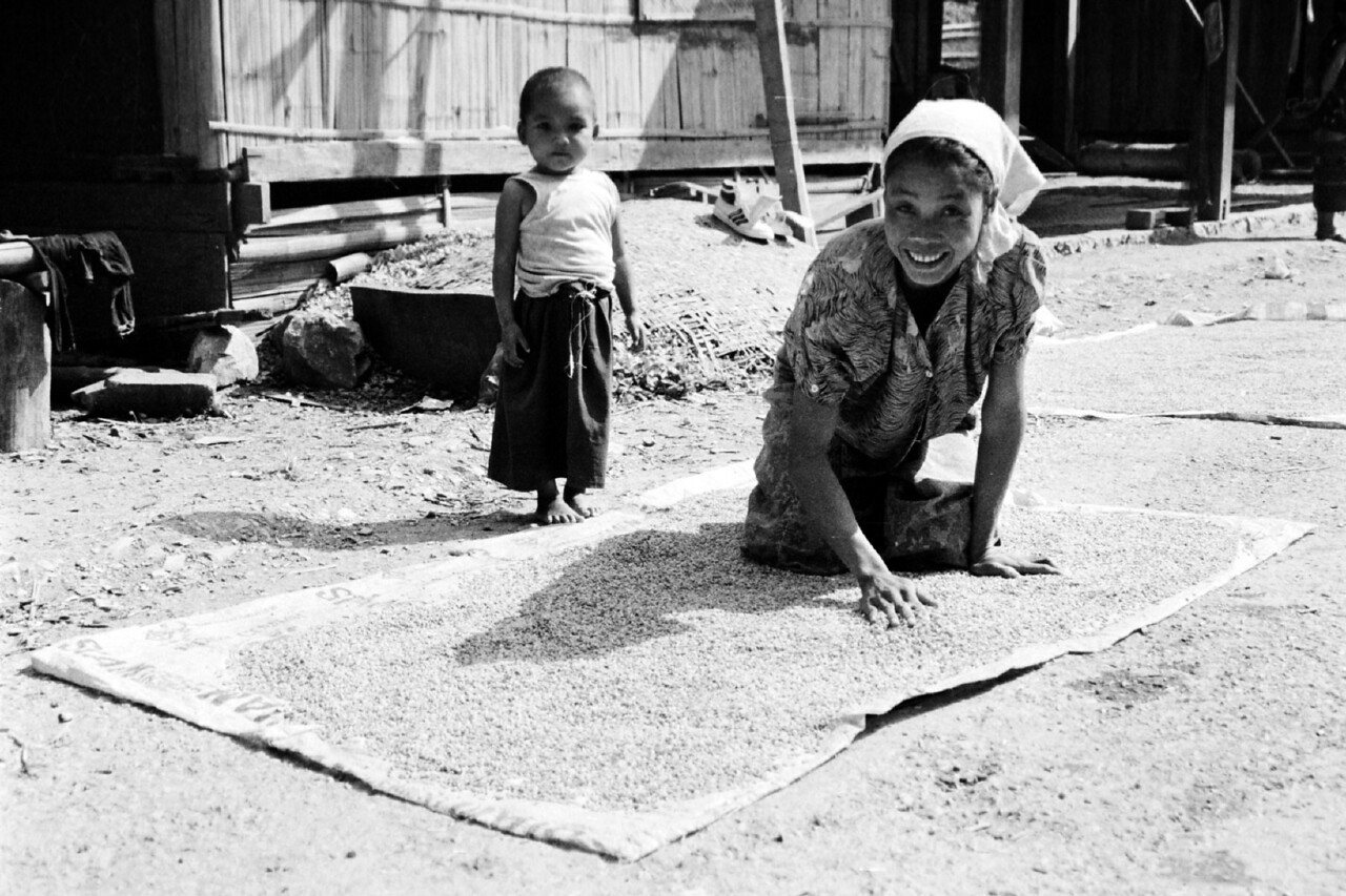 laos -mother and child  with drying mat