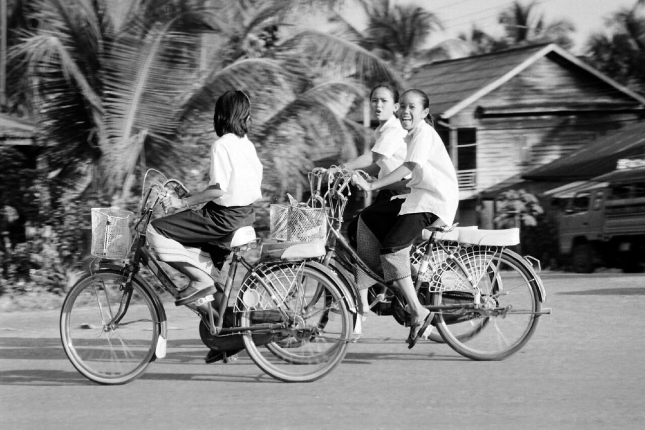 laos -three girls on cycles