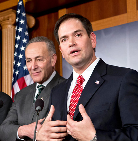 Sen. Marco Rubio, R-Fla., right, and Sen. Charles Schumer, D-N.Y., left, join a bipartisan group of leading senators to announce that they have reached agreement on the principles of sweeping legislation to rewrite the nation's immigration laws, during a news conference at the Capitol in Washington, Monday, Jan. 28, 2013. The deal covers border security, guest workers and employer verification, as well as a path to citizenship for the 11 million illegal immigrants already in this country.  (AP Photo/J. Scott Applewhite)