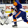 Pittsburgh Penguins goalie Marc-Andre Fleury (29) makes a save as New York Islanders center Keith Aucoin (10) skates in front of the crease in the second period of their NHL hockey game at Nassau Coliseum in Uniondale, N.Y., Tuesday, Feb. 5, 2013. (AP Photo/Kathy Willens)
