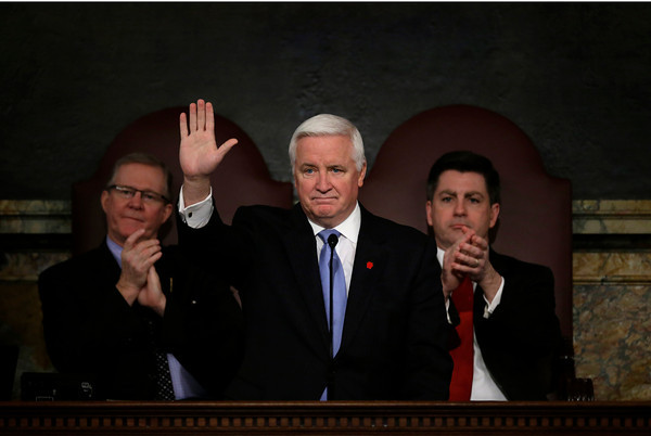 Gov. Tom Corbett delivers his budget proposal for the fiscal year 2013-2014 to a joint session of the Pennsylvania House and Senate on Tuesday, Feb. 5, 2013, in Harrisburg, Pa. Speaker of the Pennsylvania House of Representatives, Rep. Sam Smith, R-Jefferson, is seated left, and is accompanied by Pennsylvania Lt. Gov. Jim Cawley (AP Photo/Matt Rourke)