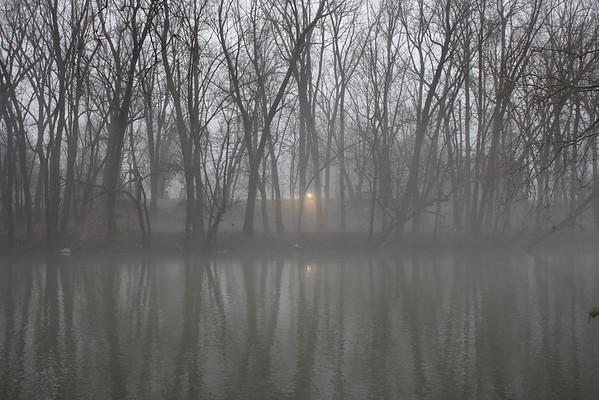 A light glows through the fog beside a house along the White River, January 28, 2013<br /> <br /> Photographer's Name: Rachel  Landers<br /> Photographer's City and State: Anderson, IN