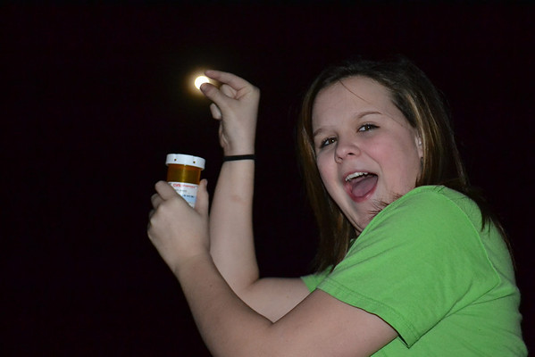Karsyn Litsey playing with the full moon.<br /> <br /> Photographer's Name: Terry Ward<br /> Photographer's City and State: Frankton, IN