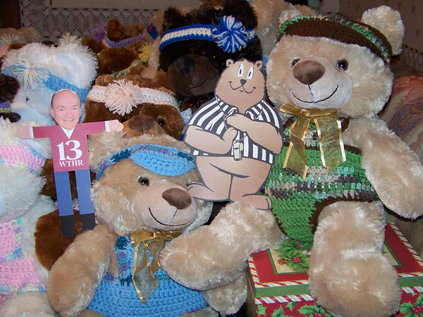 (NOTE - please crop photo and use bear on right with Time Out Teddy)  Time Out Teddy, the National Exchange Club Mascot for child abuse prevention, joins one of the many teddy bears that will be up for adoption at the 25th Annual Bids for Kids TV Auction April 26-27.  Bonny Clark of the Anderson Noon Exchange Club has been dressing the bears with crocheted outfits for several years.  Each teddy bear represents a child that can be saved from child abuse through the fundraising efforts of Bids for Kids and local Exchange Clubs.<br /> <br /> Photographer's Name: Bonny Clark<br /> Photographer's City and State: Pendleton, IN