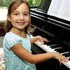 Six-year-old Mya Walker playing piano<br /> <br /> Photographer's Name: Beth Walker<br /> Photographer's City and State: Anderson, Ind.