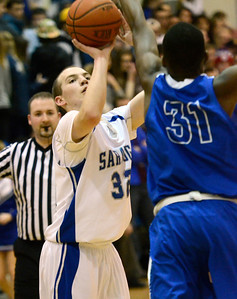 Ed Burke - The Saratogian 01/31/14 Saratoga's Zach Kircher shoots over defense by Shaker's Brian Mawejje during Friday's varsity basketball matchup at Saratoga.