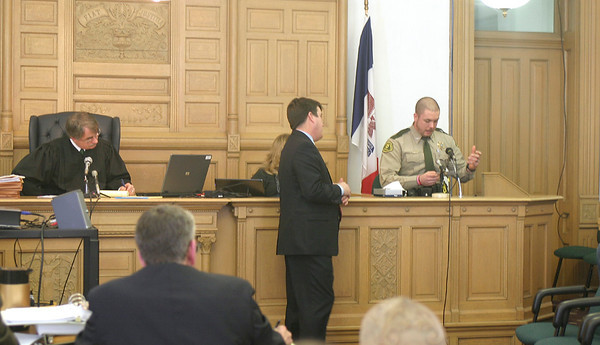 Wapello County Sheriff's Deputy Marty Wonderlin views evidence offered by the prosecution Friday during State of Iowa vs. Seth Techel. The first-degree murder case is being overseen at the Wapello County Courthouse by Judge Daniel Wilson. <br /> Mark Newman