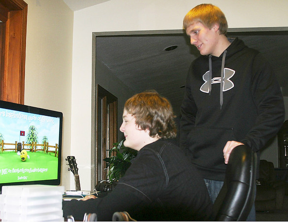 Brothers Shane and Blake Mooney of Ottumwa have worked with their family to perfect Buster Ball, a video game for mobile phones. In the process, the boys have gained skills in programming and business. <br /> Mark