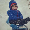 My great-nephew Ira Kane Evans, son of Dave and Maren Daunoras Evans, enjoying a sled ride.<br /> <br /> Photographer's Name: Evelyn Bauer<br /> Photographer's City and State: Anderson, Ind.