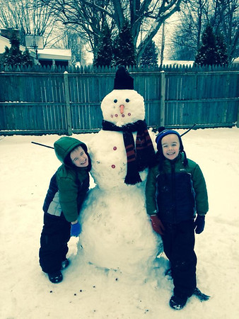 Five-year-old twins Parker and Alexander Roosa with their very first snowman!<br /> <br /> Photographer's Name: Braun Roosa<br /> Photographer's City and State: Centerville, Ind.
