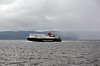 Hebrides is pursued by a shower as she pulls in to the bay