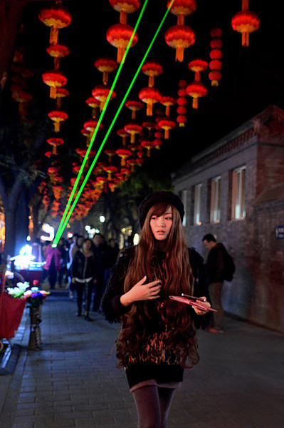 Beijing, Chine  Nov. 2013. Shopping street with lasers hitting dirty air.