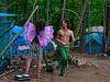 Young couple in campground with girl wearing wings and man with hula hoop.  At The Big Up concert Ghent NY, Aug. 2010