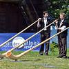 NENDAZ, SWITZERLAND – JULY 21: Frautschi (l), Rannay (c) and Reber at the 10th International Festival of Alpine horns :  July 21, 2011 in Nendaz Switzerland