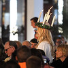 Pat Christman<br /> St. Lucia Christina Swenson walks up the aisle at Christ Chapel during the Festival of St. Lucia Thursday.