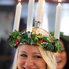 Pat Christman<br /> St. Lucia Christina Swenson smiles after having her candles lit during Thursday's Festival of St. Lucia at Gustavus Adolphus College.