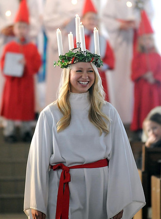 Pat Christman<br /> St. Lucia Christina Swenson carefully walks down the aisle after the chapel service at the Festival of St. Lucia Thursday.