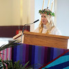 Pat Christman<br /> St. Lucia Christina Swenson reads at the chapel service during the Festival of St. Lucia Thursday.