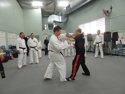 Grandmaster Angelo 8th Dan Founder Filipino Kyusho taking posture with Andy 1st Dan Combat Karate