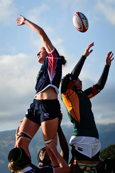 USA Rugby Women's National Team captain Kathryn Johnson (U of Wisconsin - Milwaukee) slaps the ball away from South Africa at the Nations Cup opener in Santa Barbara, CA on 7/14/2011. Photo by Lynne Skilken.