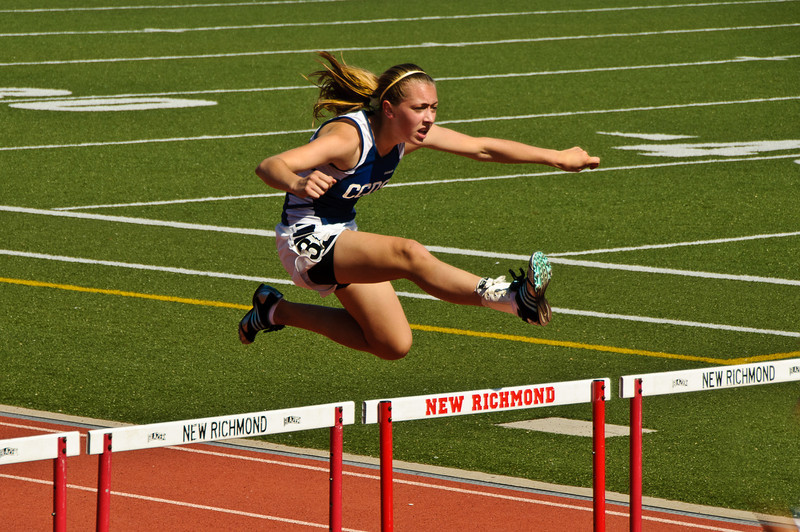 CCDS sophomore Alexis V. clears the hurdles on the first day of the Miami Valley District Finals in New Richmond, Ohio on May 21, 2009. Photo by Lynne Skilken.