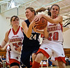 CCDS junior Jaime H. ties up the ball to help defeat the Lady Cardinals on their home court in Felicity, Ohio on January 11, 2010. Photo by Lynne Skilken.