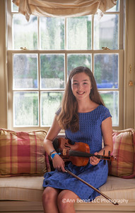 Kate Rush with her violin at her parent's home in Covington.