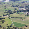 Tele lens shot of the Princes Highway and Meroo Rd, Bomaderry. Simon and Nicole's house is just out of shot top right amongst other newer houses. The hang glider pilots who launch from Cambewarra lookout land in the fields below.