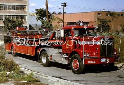 Ladder Co. 13..Diamond-Reo tractor and a Seagrave 100 foot stick..
