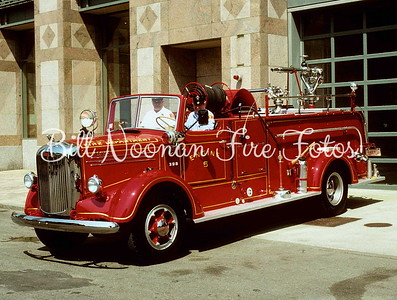 Engine 5's classic Mack Hose Wagon....what a beauty....not the original chauffeur and officer