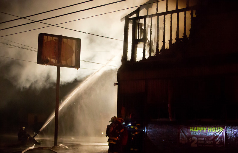 BREWER, Maine -- 07/13/2017 - Area firefighters work to extinguish a blaze at Cap's Tavern in Brewer late Thursday. Ashley L. Conti   BDN
