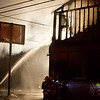 BREWER, Maine -- 07/13/2017 - Area firefighters work to extinguish a blaze at Cap's Tavern in Brewer late Thursday. Ashley L. Conti | BDN
