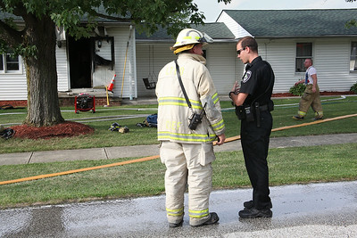 Firefighters needed about 20 minutes to contain a fire that broke out around 4:45 P.M. Monday at a home at 241 Forest Street in LaGrange. photo by Ray Riedel