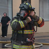 An Elkton firefighter prepares to releive other firefighters