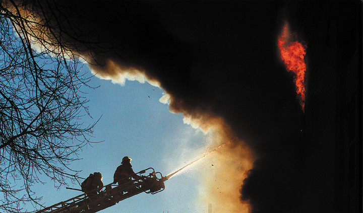 Firefighters pour water into an apartment building in Auburn.