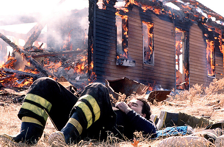 A fire fighter takes a nap after a morning of battling a control burn to learn about firefighting techniques in a training exercise in the Farmington area....