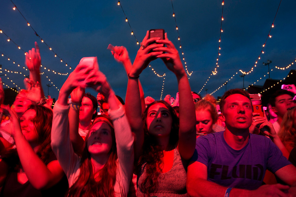 . Audience members use their cellphones to take photos and video while MGMT performs at the First City Music Festival, Saturday, August 24th, 2013 at the Monterey Fairgrounds. (Matthew Hintz/Monterey County Herald)