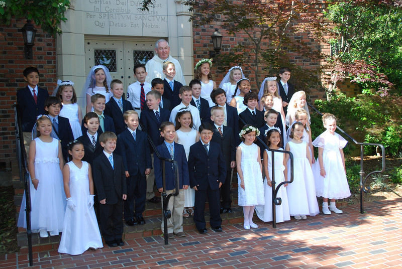 The 2009 Holy Spirit second grade class on First Communion Day with Father O'Connor