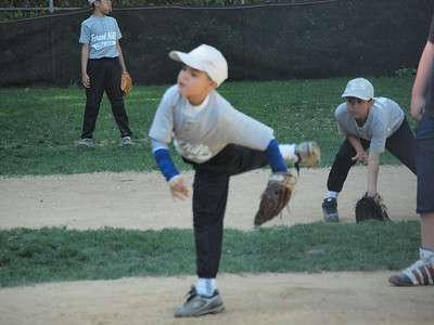 """Juliam pitching and Freddy in awesome """"ready position""""."""