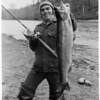Bob Blethen hoists this hefty steelhead that he caught on Washington's Cowlitz River.