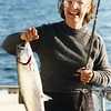 Anne with a coho salmon she caught in the Strait of Juan de Fuca near Neah Bay.