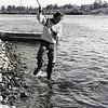 Jim Bates lands a steelhead along the Snake River.