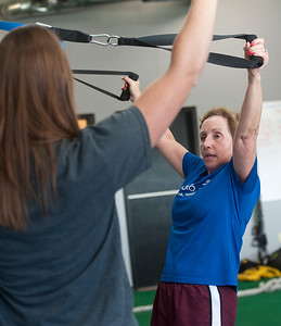 photo by Sarah A. Miller/Tyler Morning Telegraph  Instructor Kayla Williams, left, works with client Ginger Cobb of Tyler on the suspension straps Tuesday June 24 at Cor-Fit. Cor-Fit is a functional fitness studio located at 1721 S. Broadway, Suite B in Tyler.