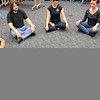 Jess Martin, Levi Herrera, Kyle Price, Joanna Mackenzie, Jennifer Goddard, Cassidy Younghans and Scott Martin, from bottom left, begin their meditation. Herb Nygren Jr 120612