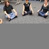 Jess Martin, Levi Herrera, Kyle Price, Joanna Mackenzie, Jennifer Goddard, Cassidy Younghans and Scott Martin, from bottom left, begin their meditation. Herb Nygren Jr 120612