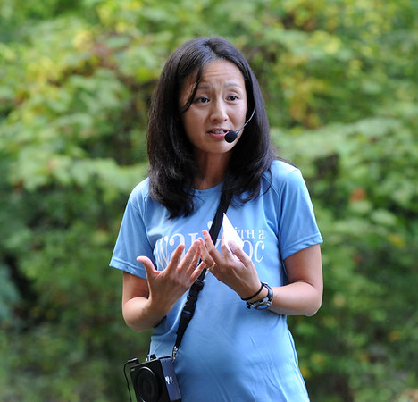 Dr. Li-Yu Mitchell, family physician and wound care specialist at ETMC, speaks during Walk With a Doc, a health literacy program sponsored by the Smith County Medical Society and Fit City Tyler. The program, which will host a different doctor each week, will touch on a different medical topic, before the doctors lead atendees on a walk across Rose Rudman Park. (Victor Texcucano/Staff)