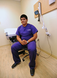 Daniel Posada sits in a patient room at the Family First Clnic in Jacksonville. (Victor Texcucano/Staff)