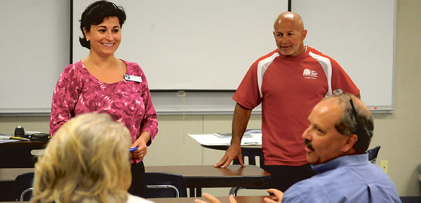 Christina Fulsom, executive director of PATH and Kelly Hitchcock, owner of KH Fitness lead the group examining the creative side of how to make the Fit City Challenge campaign a success at TJC's West Campus on Tuesday. photo: Jaime R. Carrero/Tyler Morning Telegraph