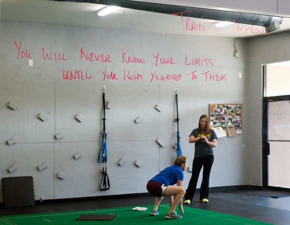 photo by Sarah A. Miller/Tyler Morning Telegraph  An inspirational quote is written on the mirror at Cor-Fit as instructor Kayla Williams, left, works with client Ginger Cobb of Tyler in a one-on-one session Tuesday June 24 at Cor-Fit. Cor-Fit is a functional fitness studio located at 1721 S. Broadway, Suite B in Tyler.
