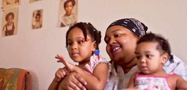 Venceta Herd, 33, holds her two daughters, Stacyaula, 4, and Sheniya, 1.